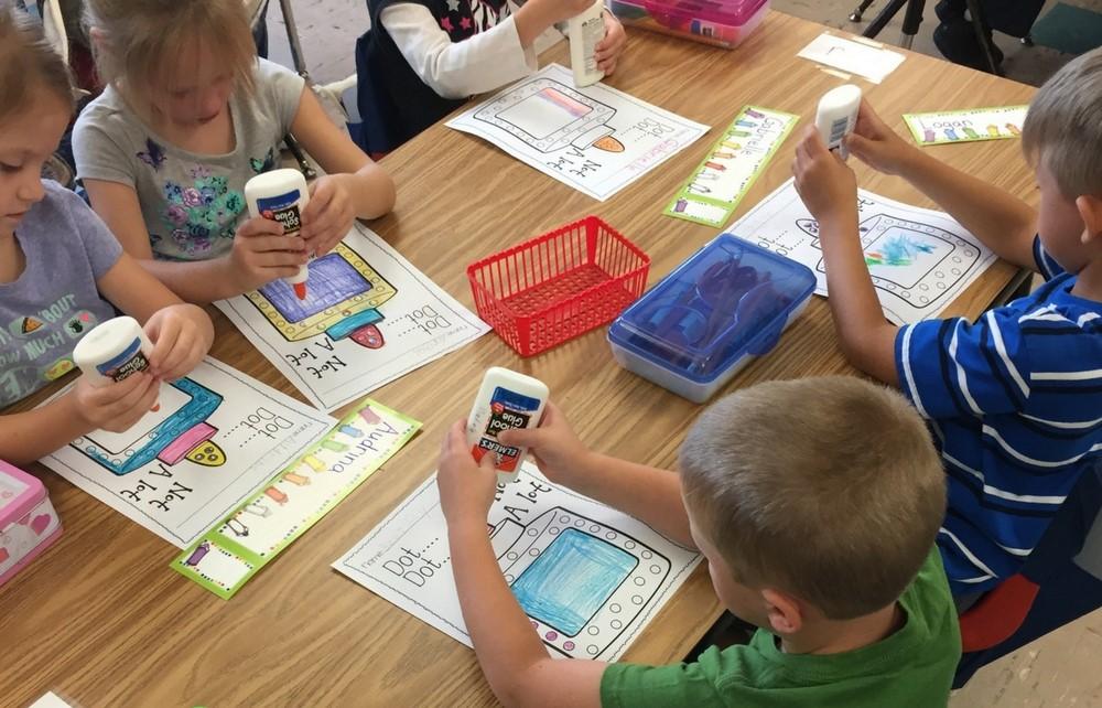 Cardinal Kindergarten Students Use Glue to Help with Classroom Skills