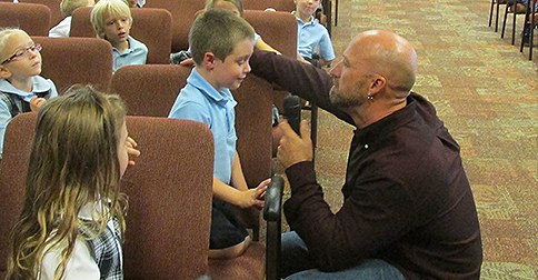Pictured is author and illustrator James Horvath with his cousin, NDES kindergarten student Jack Heller.