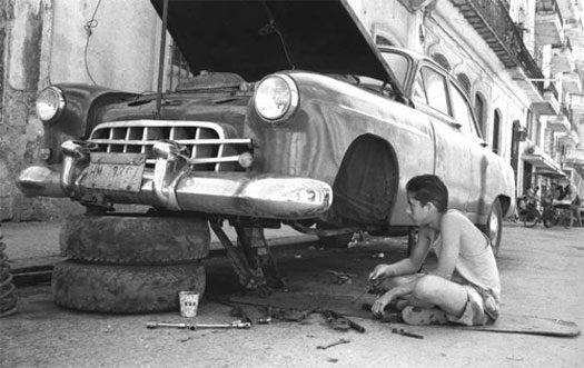 Kid Fixing Car