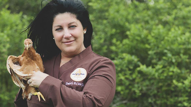 Kimberly McCune Gibson with a chicken