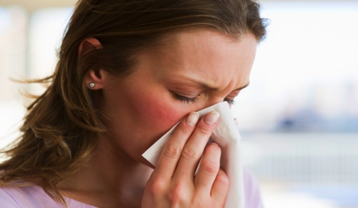 person sneezing common cold
