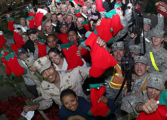 57450402f38 Notre Dame Elementary School Students Stuffed Stockings for Soldiers